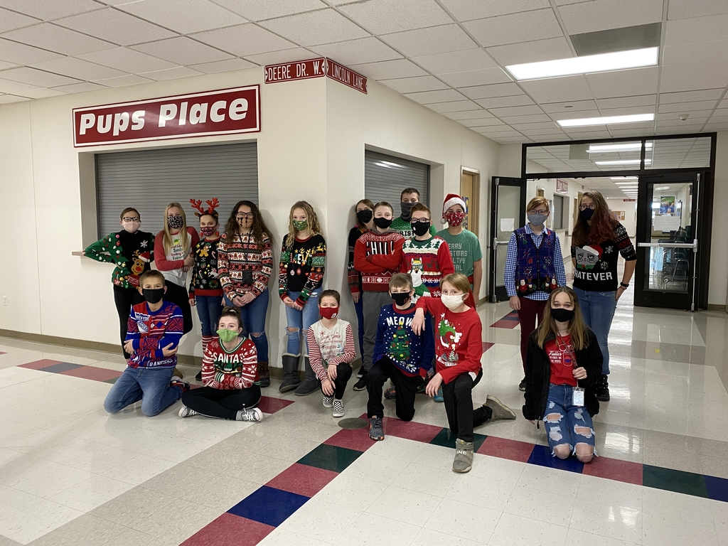 6 Red Rockin' the ugly Christmas sweaters.