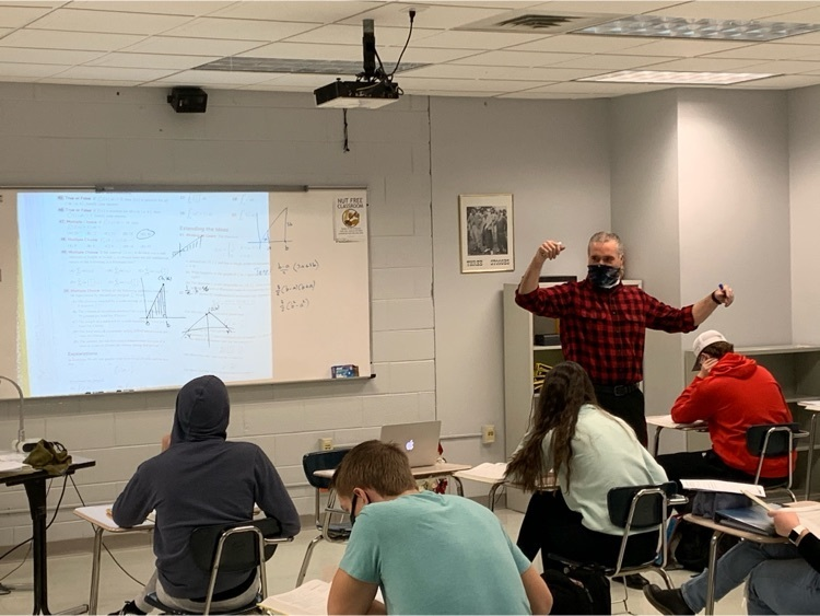 Mr. Miscik finishing up the AP Calculus lesson this morning.  They're always solving something up there.
