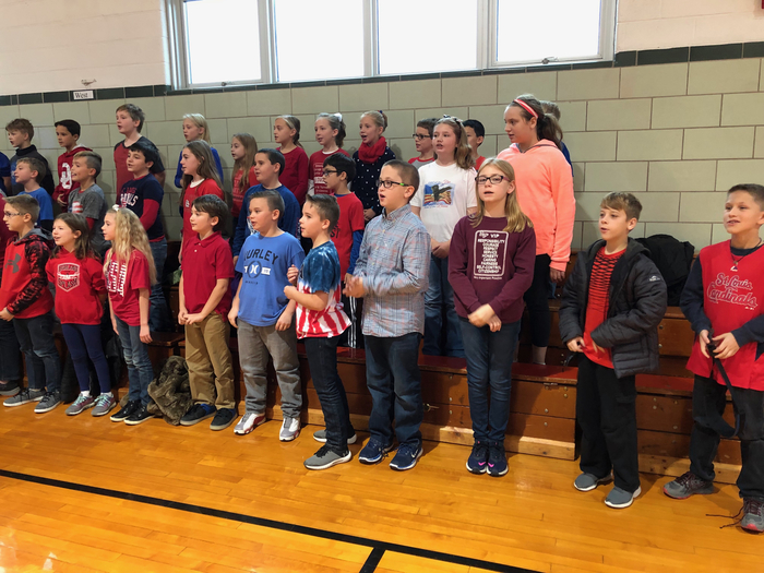 4th and 5th graders singing to our veterans