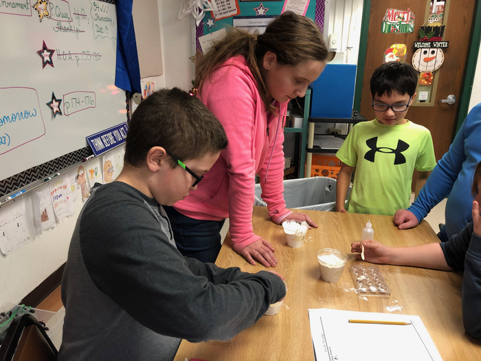 Students perform tests to identify 3 mystery powders.