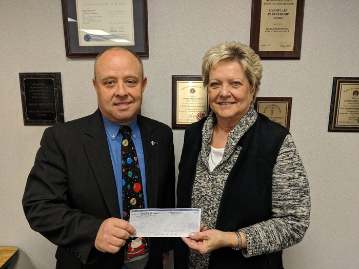 Sherry Fletcher presents check for $500 to Mike Sutton