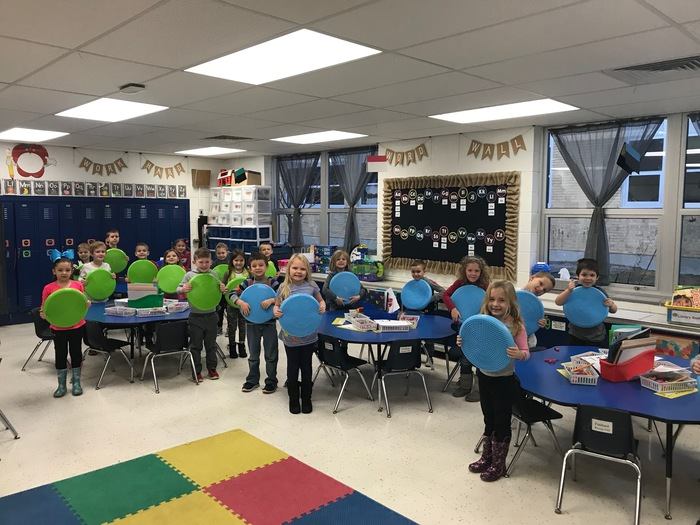 Kindergarten class gets wiggle seats through grant.