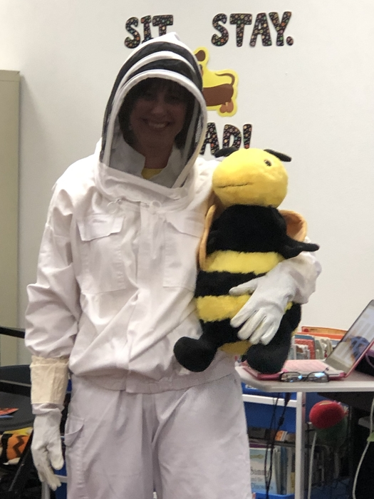 Mrs. Laird all geared up in her beekeeper suit!  Wow she caught a BIG bee!!