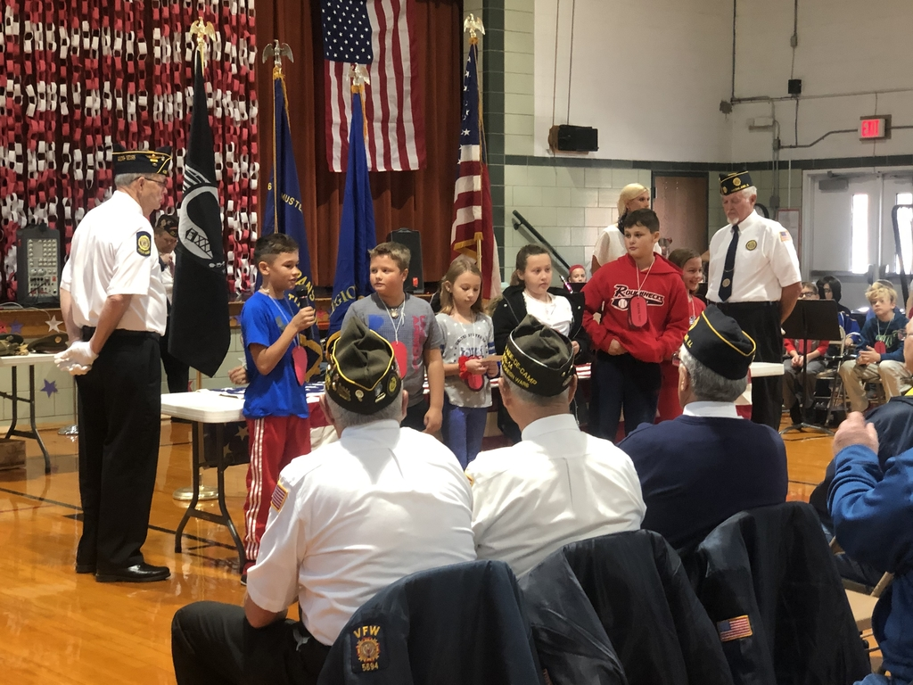 Fourth grade students reciting a poem to pay tribute to Veterans.